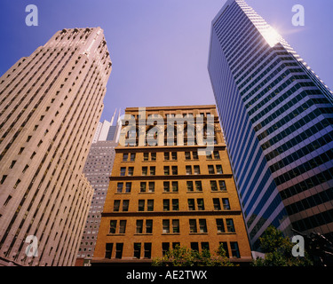 view from under three skyscrapers in San Francisco reaching up into the sky - Stock Photo