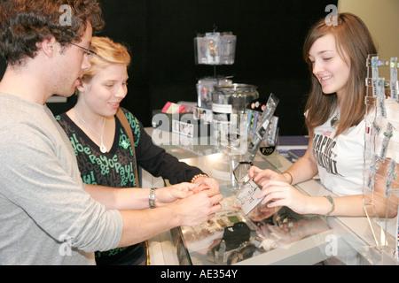 Ohio Cincinnati Contemporary Arts Center CAC Store couple shopping gifts female clerk - Stock Photo