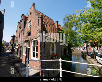 Small crooked warped old house Kerkstraat streetcorner historic city centre of Delft the Netherlands NO fisheye - Stock Photo