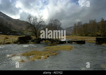 horizontal landscape photo of slater bridge in little langdale in the english lake district - Stock Photo