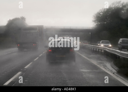 Driving with poor visibility in the rain on a dual carriageway in england. - Stock Photo
