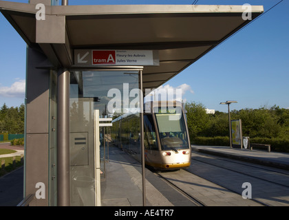 a tram arriving at a stop in Orleans France - Stock Photo