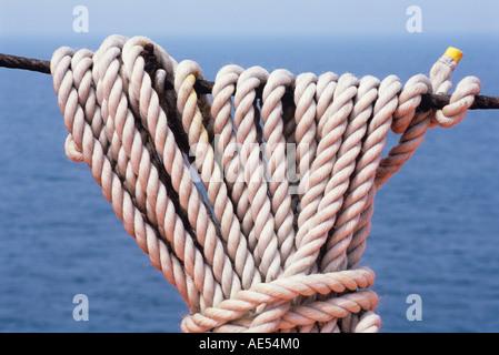 coiled natural fibre cordage hemp/manilla/sisal on guardrails of ship/pride of bilbao, portsmouth, england, uk - Stock Photo