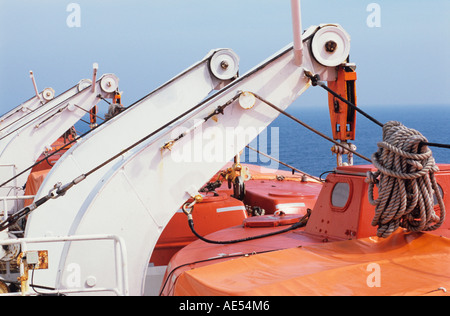 lifeboat and davit against a blue sly in the bay of biscay on the pride of bilbao, portsmouth, england, uk - Stock Photo