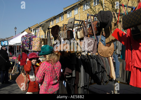 Hats and bags for sale on market stall on Portobello Road market, Notting Hill, London, England, UK - Stock Photo