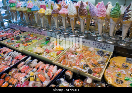 Plastic sushi and ice cream cones on display at a store selling fake food for display in Japanese restaurants - Stock Photo