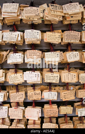 Rows of wooden votive plaques - ema - with wishes and prayers at Meiji Jingu shrine in Tokyo Japan - Stock Photo
