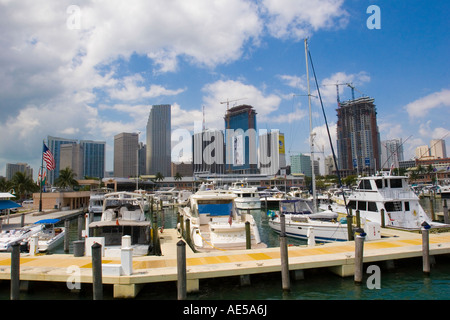 Skyscrapers of the downtown Miami skyline with boats in the Bayside Marina in Biscayne Bay Miami Florida - Stock Photo