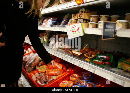 Young Woman in the supermarket, Bamberg, Bavaria, Germany, Europe, EU - Stock Photo