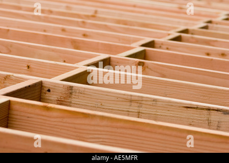 Wood Blocking In A Staggered Pattern Between Floor Joists At A Stock