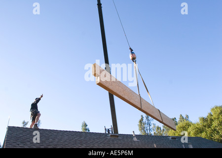 Man hand signals crane operator during loading of ...