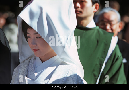 Japanese bride in her wedding dress and headcloth Meiji Shrine in Central Tokyo New Year Japan - Stock Photo