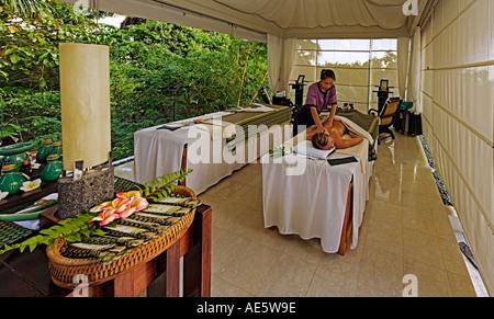 Woman having massage in the exclusive luxury Banyan Tree Resort Seychelles Property released Model released - Stock Photo