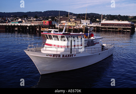 SUR RANDY fishing boat in MONTEREY HARBOR with FISHERMAN S WHARF in background CALIFORNIA - Stock Photo