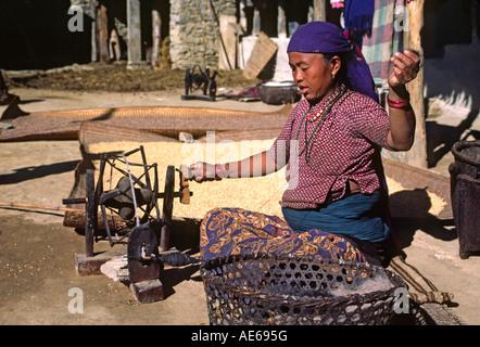 Village woman spins wool into thread SIKLIS NEPAL HIMALAYA - Stock Photo