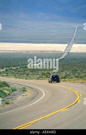 Car on asphalt desert highway 190 through Panamint Valley Death Valley National Park California - Stock Photo