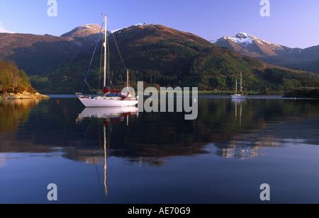Yachts at anchor on a still Loch Leven near Ballachulish UK - Stock Photo