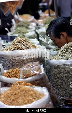 Malaysian Dried Goods Stall in the Sunday Market, Kuching, Sarawak, Borneo, Malaysia - Stock Photo