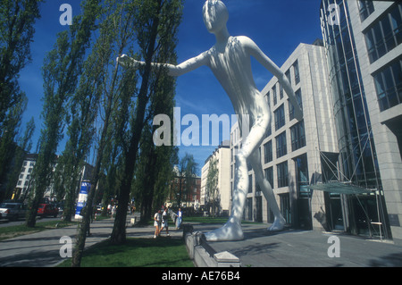 walking man giant sculpture before th building of th allianz stock photo royalty free image. Black Bedroom Furniture Sets. Home Design Ideas