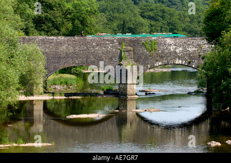 Narrow boat crossing Brynich Aqueduct over the River Usk on the Mon Brecon Canal near Llanfrynach Powys South Wales - Stock Photo