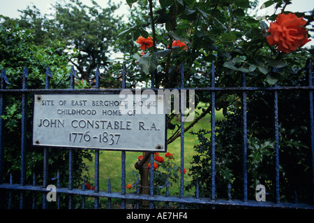 Sign on the wrought Iron railings around the site of John Constable s childhood home East Bergholt Suffolk - Stock Photo