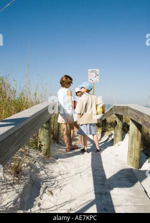 Children standing on beach walkway - Stock Photo