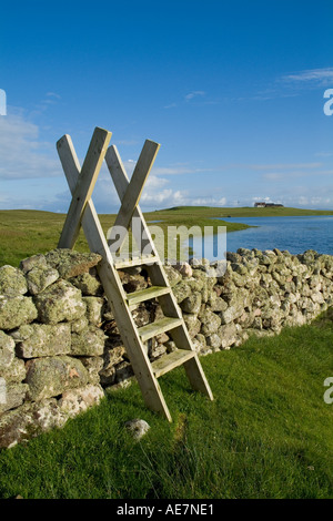 dh Loch of Breckon ESHA NESS SHETLAND Country walkers stile ladder over dry stone dyke