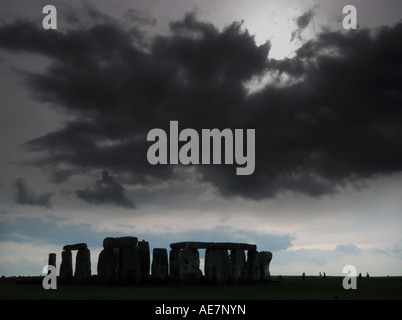 Stonehenge prehistoric monument in Wiltshire UK under a dark threatening sky (manipulated colours) - Stock Photo