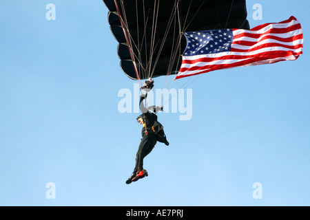 United States Military SOCOM Parachutist with American Flag at MacDill Air Fest in Tampa Florida USA - Stock Photo