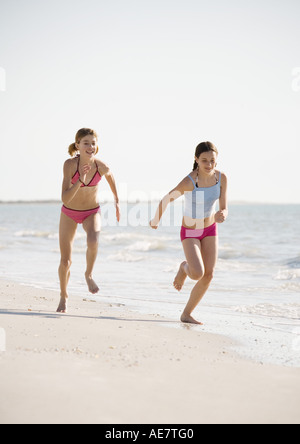Two Preteen Girls On Beach One Tickling The Other Stock