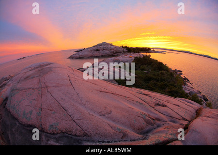Sunset over island in Georgian Bay Ontario Canada - Stock Photo