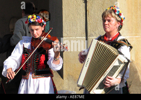 Two female musicians play traditional Polish folk music in Market Square, Krakow, Poland. - Stock Photo