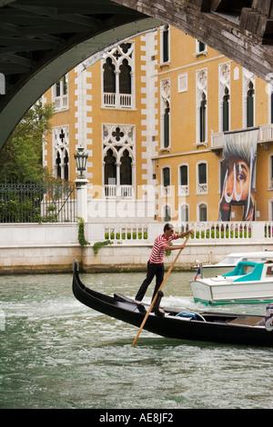 Gondola on the Grand canal passes under the Academia Bridge Venice Italy - Stock Photo