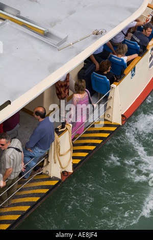 Overhead view of passengers on a Vaporetto on the Grand canal from the Academia Bridge Venice Italy - Stock Photo
