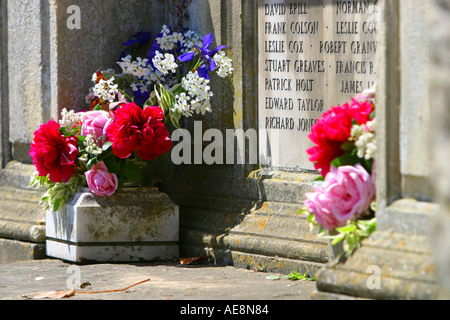 Fresh flowers on the war memorial in Lacock High Street - Stock Photo