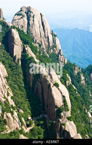 Hikers Climbing Stone Stairs up a Peak Huangshan Mountains China - Stock Photo