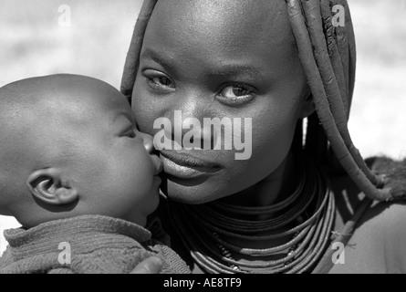 Himba mother baby Kaokoveld south of Opuwo Namibia Monochrome photograph - Stock Photo