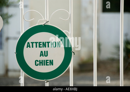 Image of a Attention au Chien Sign on a Metal Gate - Stock Photo