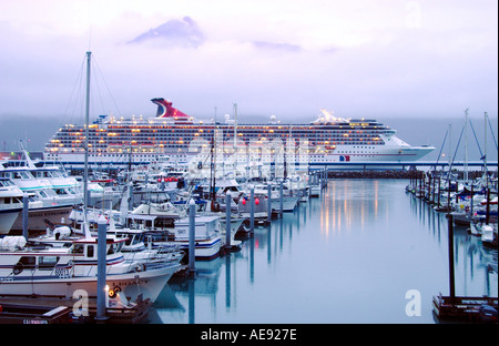 An evening view of the marina and cruise ship Carnival Spirit docked in Seward, Alaska USA - Stock Photo
