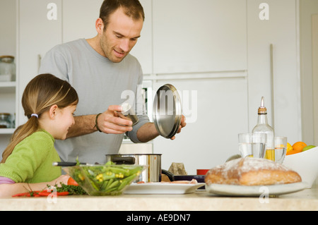 Man and little girl cooking - Stock Photo