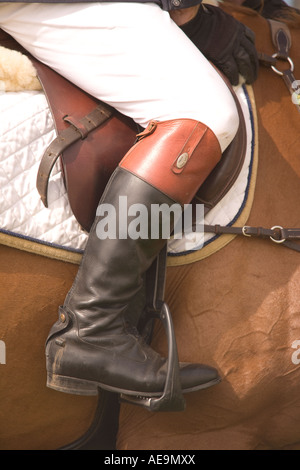 Equestrian sport horse riders show jumping competition a riders leg and boot in stirrup at Dumfries Agricultural - Stock Photo