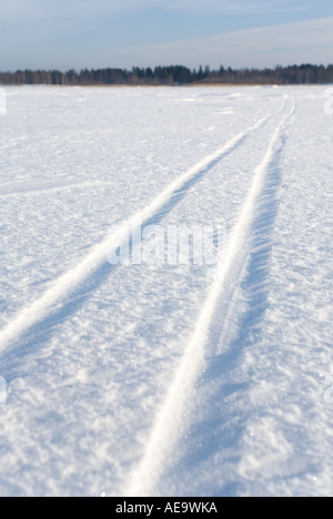 Cross-country Ski track on unbroken snow on sea ice , Finland - Stock Photo
