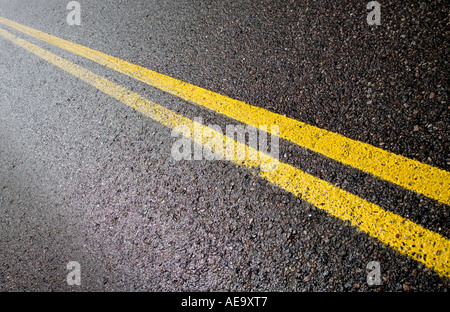 Two yellow barrier lines painted to tarmac