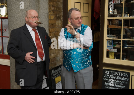 Men smoking cigars smokers outside a smoking smokers shop Covent Garden west central London England  UK 2000s HOMER - Stock Photo
