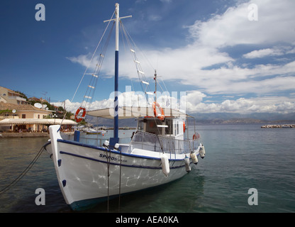 Spiros a small tourist boat in the harbour of Kassiopi - Stock Photo