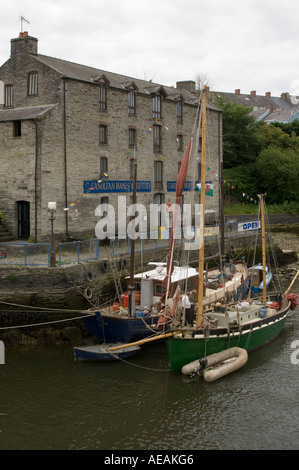 Boats moored outside Cardigan Wales Heritage centre (converted warehouse) on the banks of the River Teifi Tivy, - Stock Photo