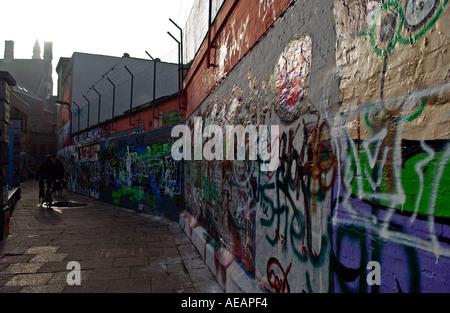 Graffiti on walls in Werregaren Straat Ghent Belgium - Stock Photo