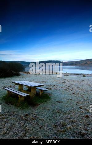 Picnic bench at Fernworthy Reservoir in dartmoor National Park near Moretonhampstead Devon on a cool crisp morning - Stock Photo