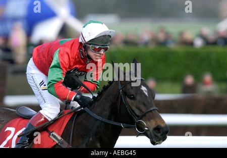 Jockey Richard Johnson riding race horse Jimmy Tennis in the Royal and Sun Alliance Chase at the Cheltenham Festival - Stock Photo