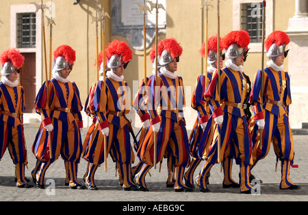 SWISS GUARDS IN PLUMED HELMETS AND STRIPED UNIFORMS AT THE VATICAN CITY - Stock Photo